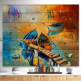 Designart 'Two Boats in Pier at Golden Sunset' Sea & Shore Painting Print on Natural Pine Wood - Blue