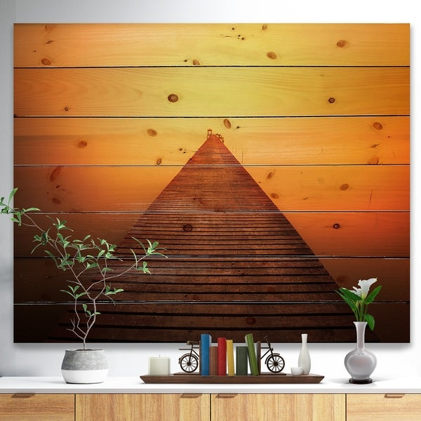 Designart 'Old Wooden Bridge into Infinity Sea' Pier Seascape Print on Natural Pine Wood - Orange