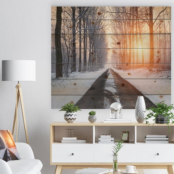 Designart 'Bright Sun Break in Winter Forest' Forest Print on Natural Pine Wood - White
