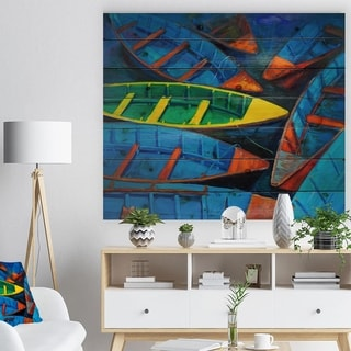 Designart 'Colorful Boats and Jetty' Nautical Painting Print on Natural Pine Wood - Blue