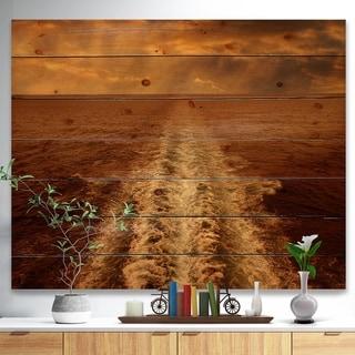Designart 'Dusk in the Ocean' Sea & Shore Painting Print on Natural Pine Wood - Brown