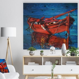 Designart 'Red Boat over the ocean' Sea & Shore Painting Print on Natural Pine Wood - Blue