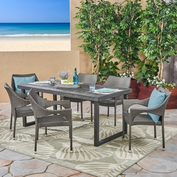 Lecanto Outdoor 7 Piece Acacia Wood Dining Set with Stacking Wicker Chairs by Christopher Knight Home