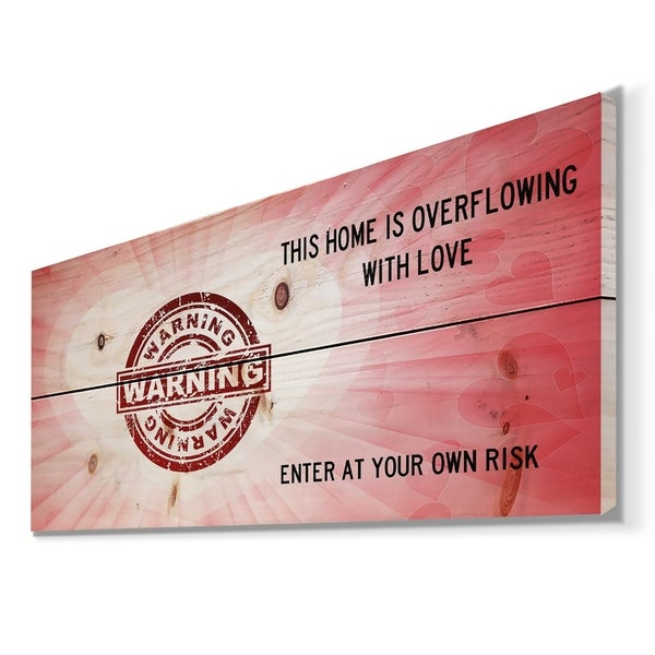 Designart 'Warning. This house is Overflowing with love. Pink Heart' Textual Entrance Art on Wood Wall Art - Red
