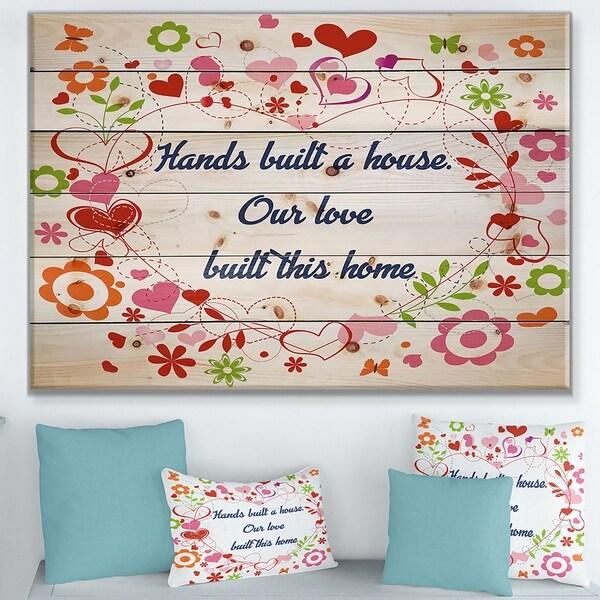 Designart 'Hands built a house. Floral heart' Textual Entrance Art on Wood Wall Art - Blue/Pink