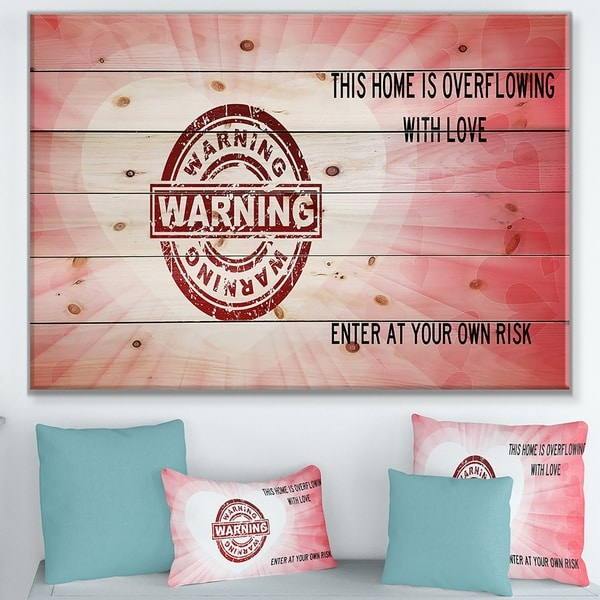 Designart 'This house is Overflowing with love. Pink heart Warning' Textual Entrance Art on Wood Wall Art - Red