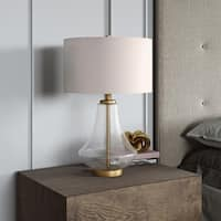Table lamp in clear seeded glass and brushed brass