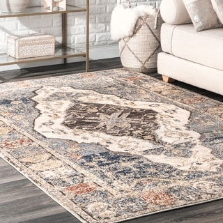The Curated Nomad De Haro Tribal Plaque Medallion Faded Border Area Rug