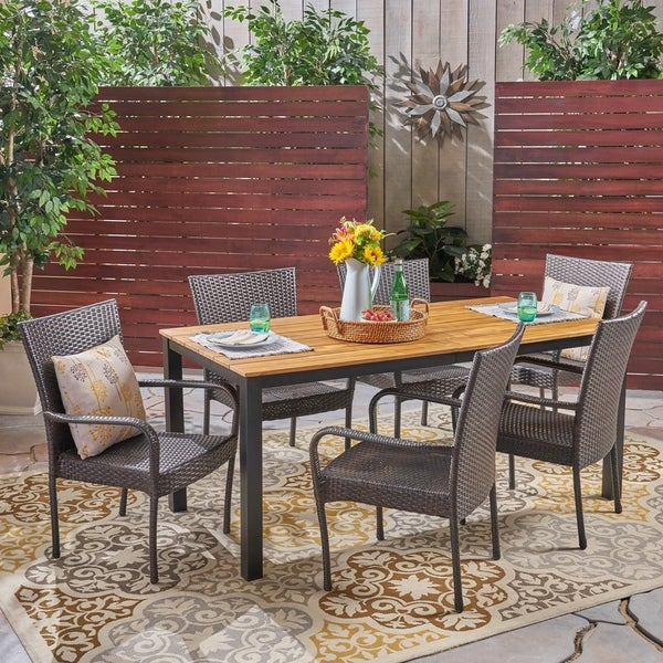 Coleman Outdoor 7 Piece Acacia Wood Dining Set with Stacking Wicker Chairs by Christopher Knight Home