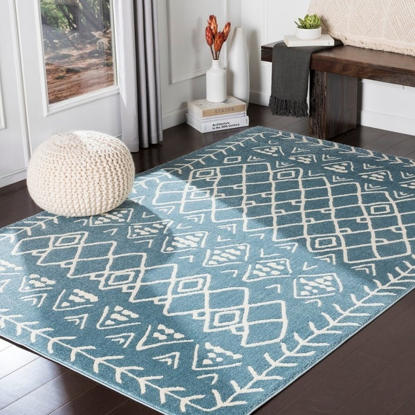 "Xia Blue Bohemian Nomad Area Rug - 8'10"" x 12'6"". Opens flyout."