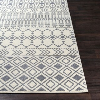 The Curated Nomad District Cream/ Black Boho Area Rug - 6'7 x 9'6