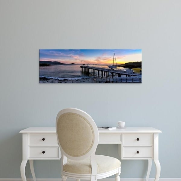 Easy Art Prints Panoramic Images's 'Pier and sailboat at sunset on Stillwater Cove, Pebble Beach, California' Premium Canvas Art