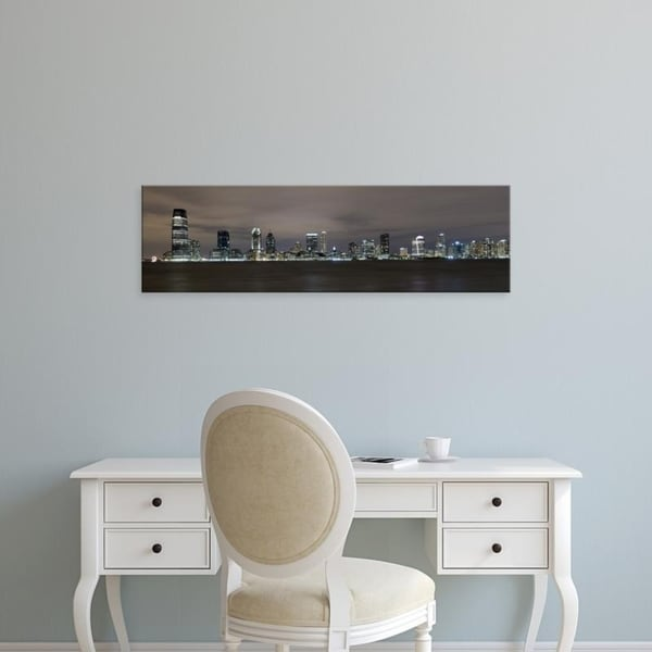 Easy Art Prints Panoramic Images's 'Buildings in city lit up, Hudson River, Jersey City, Hudson New Jersey' Premium Canvas Art