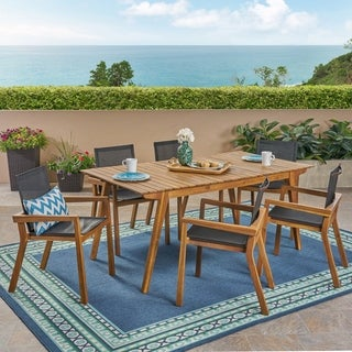 Link to Copperfield Outdoor Acacia Wood 7 Piece Dining Set with Mesh Seats by Christopher Knight Home Similar Items in Patio Furniture