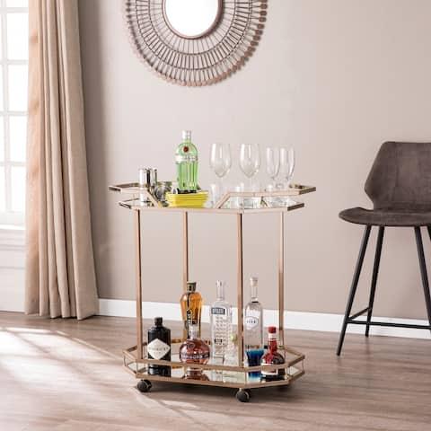 Areida Champagne Gold Oval Metal Bar Cart