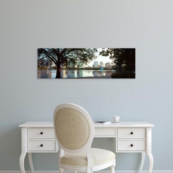 Easy Art Prints Panoramic Images's 'Buildings at the waterfront, Lake Eola, Orlando, Orange County, Florida' Premium Canvas Art