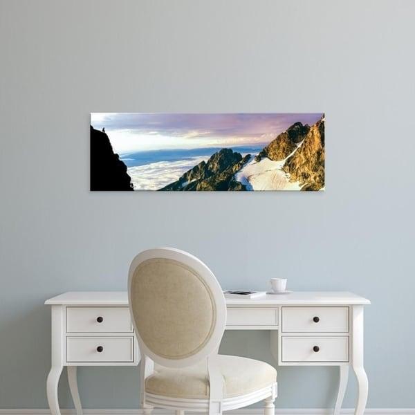 Easy Art Prints Panoramic Images's 'Hiker at cliff, Jackson Hole, Grand Teton National Park, Wyoming, USA' Premium Canvas Art