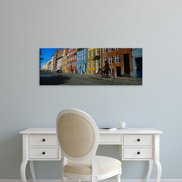 Easy Art Prints Panoramic Images's 'Woman Riding A Bicycle, Copenhagen, Denmark' Premium Canvas Art