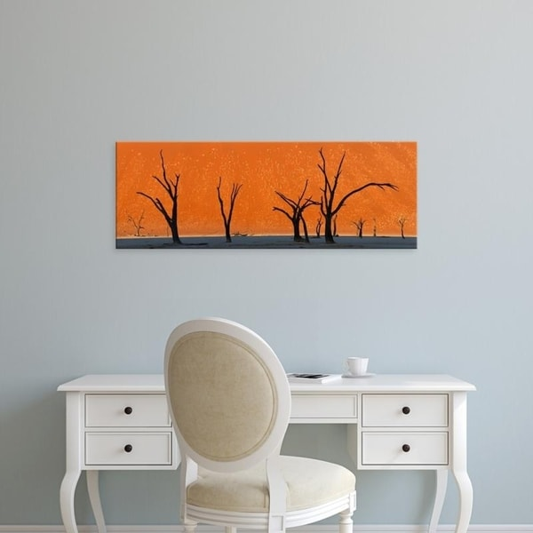 Easy Art Prints Panoramic Images's 'Dead trees by red sand dunes, Dead Vlei, Namib-Naukluft National Park, Namibia' Canvas Art