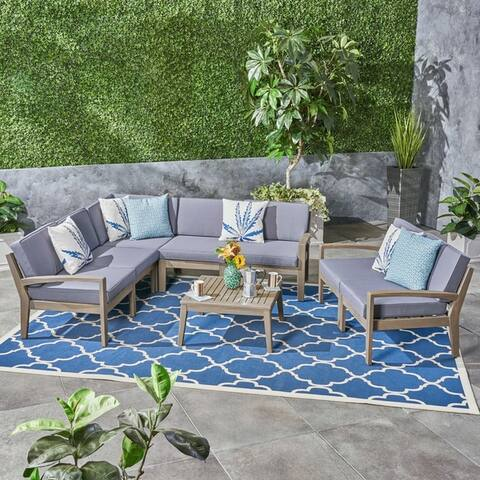 Grenada Outdoor Acacia Wood 7 Seater Sectional Sofa and Loveseat Set with Coffee Table by Christopher Knight Home