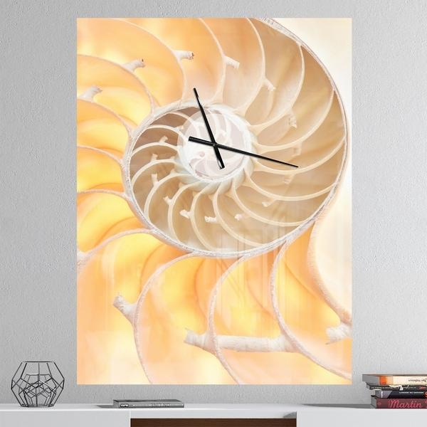 Designart 'Golden Nautilus Shell Pattern' Oversized Coastal Wall CLock