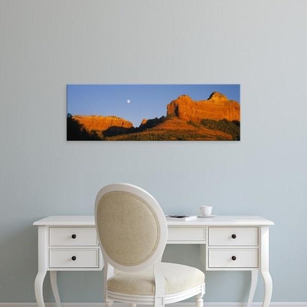Easy Art Prints Panoramic Images's 'Low angle view of Moon over red rocks, Sedona, Arizona, USA' Premium Canvas Art