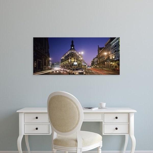 Easy Art Prints Panoramic Images's 'Streets lit up at dusk, Gran Via, Madrid, Spain' Premium Canvas Art