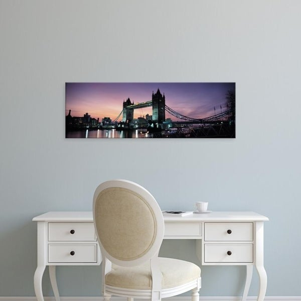Easy Art Prints Panoramic Images's 'Drawbridge lit up at dusk, Tower Bridge, Thames River, London, England' Premium Canvas Art