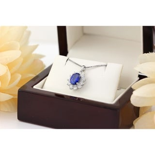 18k Gold Fancy Oval Shaped 1 3/8ct Royal Blue Sapphire and 5/8ct TDW Diamond Halo Necklace by Auriya