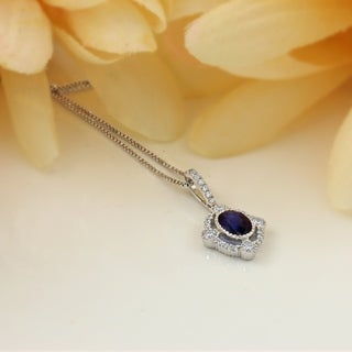 18k Gold Fancy Oval Shaped 9/10ct Royal Blue Sapphire and 1/3ct TDW Diamond Halo Necklace by Auriya