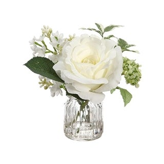 Rose and lilac in glass vase