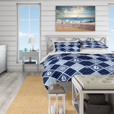 Designart 'Anchor and sailboat on blue waves' Coastal Bedding Set - Duvet Cover & Shams