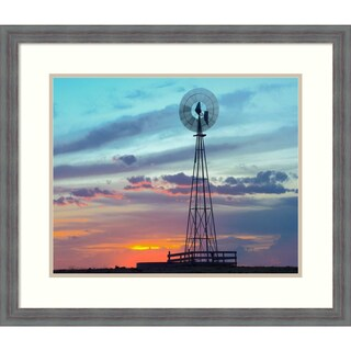 Framed Art Print 'Windmill producing electricity at sunset example of renewable energy, North America' by Tim Fitzharris