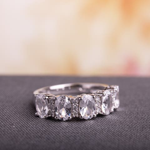 Miadora 10k White Gold Created White Sapphire and 1/10ct TDW Diamond Oval-Cut Anniversary Band