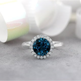 14KT Fancy 2 1/2ct Round London Blue Topaz and 1/4ct TDW Diamond Halo Engagement Ring by Auriya
