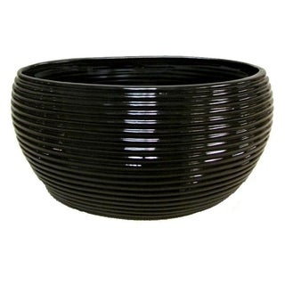 Glazed black contemporary oval pot with horizontal line indents