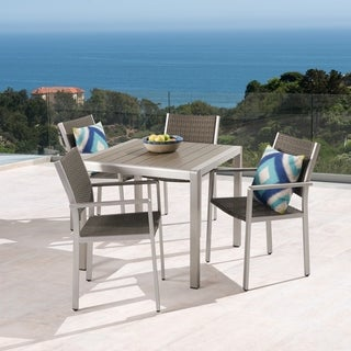 Link to Cape Coral Outdoor 4-Seater Aluminum and Faux Wood Dining Set by Christopher Knight Home Similar Items in Outdoor Dining Sets