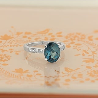 14KT Fancy 3 1/3ct Oval London Blue Topaz and 1/4ct TDW Diamond Engagement Ring