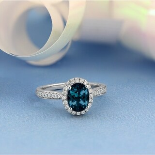 14KT Fancy 1 9/10ct Oval London Blue Topaz and 1/4ct TDW Diamond Halo Engagement Ring
