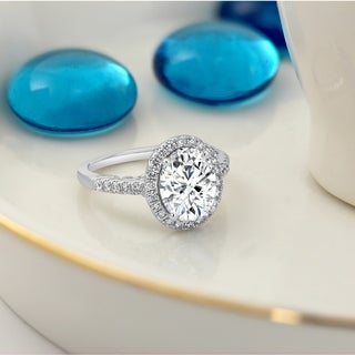 14k Gold Oval Shaped 2 1/4ct Moissanite and 3/8ct TDW Diamond Halo Engagement Ring by Auriya