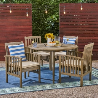 "Link to Casa Outdoor 4-Seater 47"" Round Acacia Dining Set with Straight Legs by Christopher Knight Home Similar Items in Patio Furniture"