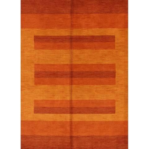"Carson Carrington Kuberup Hand-knotted Wool Orange Area Rug - 8'0"" x 5'10"""