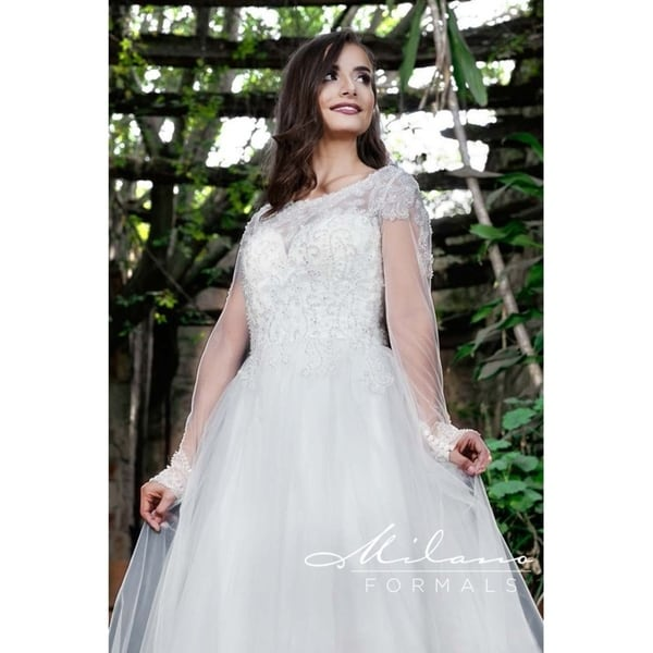 Shop Magical Lacey Long Sleeved Wedding Dress From Milano Formals