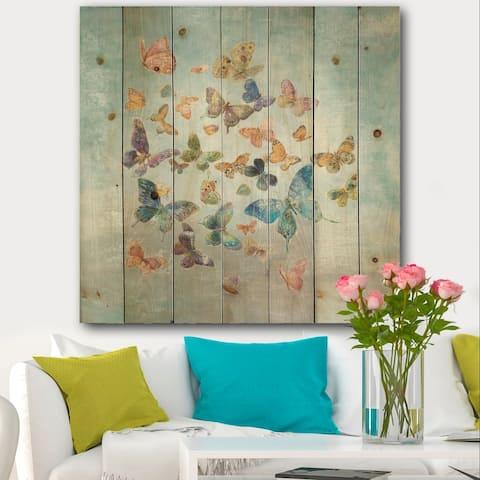 Designart 'Butterflies Dancing I' Wildlife Print on Natural Pine Wood - Grey/Blue