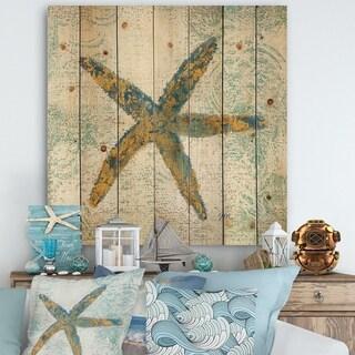 Designart 'Coastal Pastel seashells III' Vintage Nautical Print on Natural Pine Wood - Blue