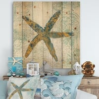 Designart 'Coastal Pastel seashells III' Vintage Nautical Print on Natural Pine Wood - Blue