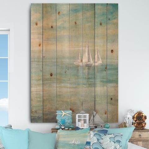 Designart 'Sunrise Boat II' Nautical & Coastal Print on Natural Pine Wood - Blue