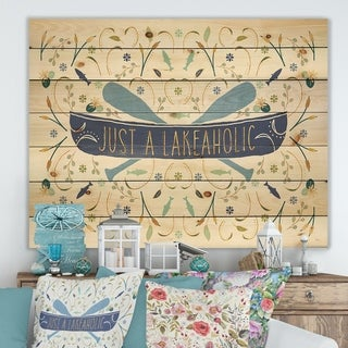 Designart 'Just a Lakeaholic ' Lake House Print on Natural Pine Wood - Blue
