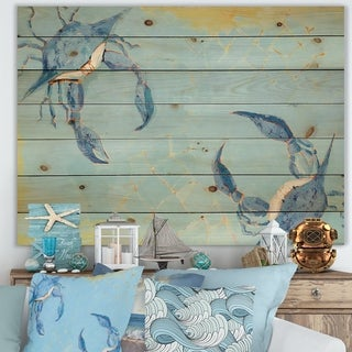Designart 'Blue Coastal crab Battle' Nautical & Coastal Print on Natural Pine Wood - Blue