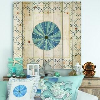 Designart 'Blue Conch Shell On Blue Coastal Pattern ' Nautical & Coastal Print on Natural Pine Wood